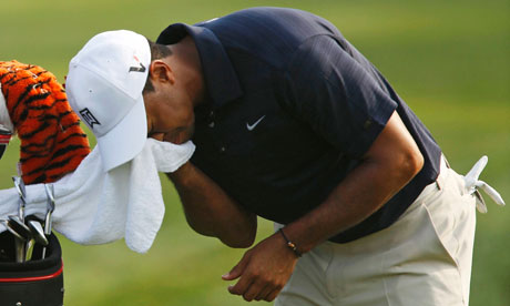 Tiger Woods wipes his face during a sorry day for him at Players Championship in Florida