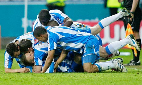 Huddersfield players celebrate Danny Ward's goal
