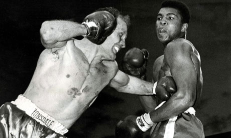 Henry Cooper lands a punch on Muhammad Ali  in their heavyweight title fight in June 1963
