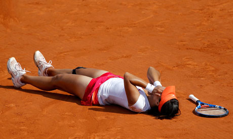 Li Na of China after winning the French Open final against Francesca ...