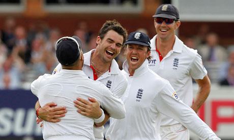 James Anderson celebrates taking the wicket of Suresh Raina