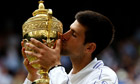 Novak Djokovic of Serbia kisses the trophy after beating Rafael Nadal in the Wimbledon final