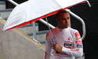 Lewis Hamilton walks in the pitlane during the second practice session for the British Grand Prix
