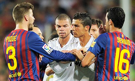 Gerard Pique argues with Real Madrid players