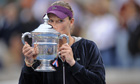 Australia's Samantha Stosur kisses the trophy after her victory over Serena Williams