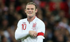 Wayne Rooney adjusts his England captain's armband