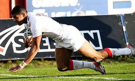 England's Kallum Watkins scores his side's fifth try against France at Craven Park in Hull