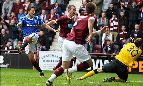 Rangers Andrew Little, left, scores his sides second goal against Hearts