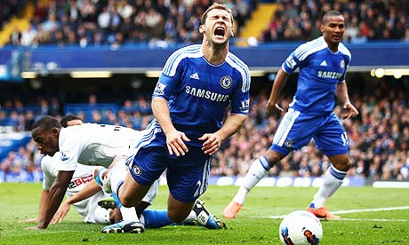 Chelsea defender Branislav Ivanovic goes to ground after a challenge by Maynor Figueroa