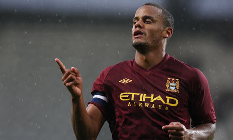 Vincent Kompany celebrates scoring Manchester City's second goal