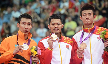 China's Lin Dan (C) Chen Long (R) and Ma