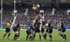 England captaincy contender Tom Wood wins a lineout for Northampton against the Ospreys