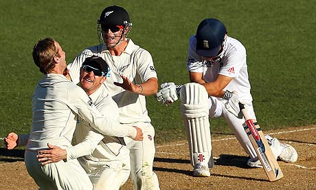 New Zealand celebrate the wicket of Alastair Cook of England