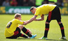 Matej Vydra is helped to his feet by Watford team-mate Mark Yeats after losing to Leeds United