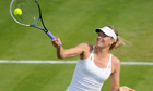 Maria Sharapova on Court Two during her defeat by Michelle Larcher De Brito at Wimbledon.