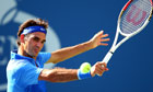 Roger Federer returns a shot during his victory over Grega Zemlja at the US Open