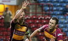 Huddersfield Giants' Luke Robinson celebrates after scoring the Giants' ninth try against Hull FC