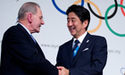 Japan's Prime Minister Shinzo Abe shakes hands with Jacques Rogge after Tokyo land the 2020 Games