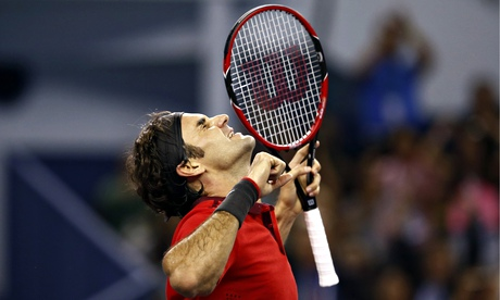 Roger Federer celebrates after defeating Gilles Simon in the final of the Shanghai Masters