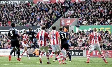 Tottenham Hotspur's Danny Rose, third left, scores against Stoke City in the Premier League