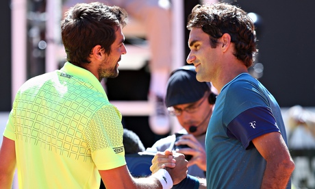 Roger Federer, right, congratulates Jeremy Chardy, who beat the Swiss 1-6, 6-3, 7-6 at the Rome Open