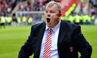 Rotherham manager Steve Evans appeals for fans to leave the pitch after they staged a premature pitc