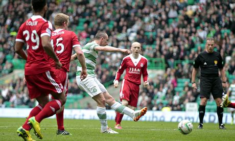 Celtic's Scott Brown, centre, scores the opening goal against Aberdeen in the Scottish Premeirship