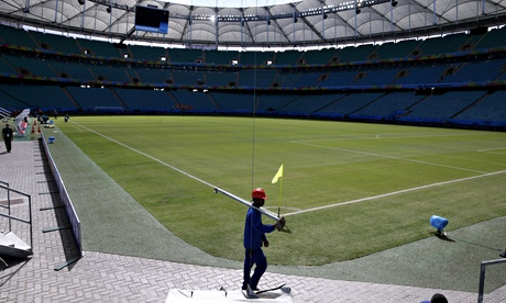 A worker carries a metal tube inside the Arena Fonte Nova stadium in Salvador on Thursday.