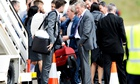 England manager Roy Hodgson with members of his staff at Luton Airport after returning home from the