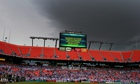 The scoreboard at the Sun Life Stadium in Miami explains to fans that the game has been stopp