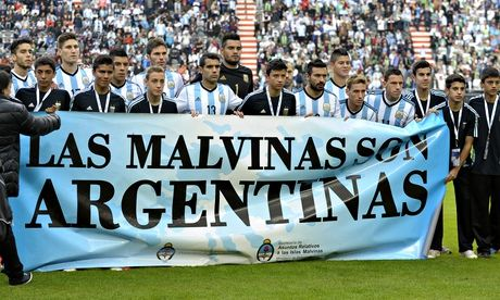 Argentina's footballers pose for photographers holding a Malvinas banner before their friendly again