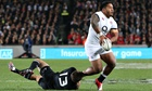 Manu Tuilagi of England is tackled by New Zealand's Conrad Smith during the Test match at Eden Park