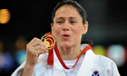 Seotland's Louise Renicks celebrates her gold in the -52kg category of the judo in Glasgow.