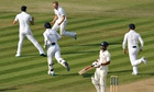 England's Joe Root runs off in celebration after taking the wicket of India's Shikhar Dhawan on the