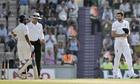 James Anderson, right, and Ajinkya Rahane exchange words as umpire Rod Tucker gestures between them
