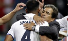 Costa Rica's Michael Umaña is hugged by the coach, Jorge Luis Pinto.