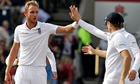 England's Stuart Broad, left, celebrates after taking the wicket of India's Pankaj Singh