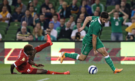 Ireland's Shane Long slips past Oman's Saad Al-Mukhaini during the friendly at Aviva Stadium on Wedn