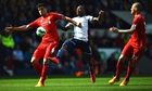 Liverpool's Dejan Lovren and Victor Anichebe of West Brom compete in the Premier League