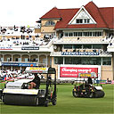 Groundsmen clear the rain at Trent Bridge