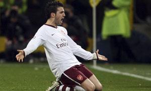 Arsenal's Cesc Fabregas celebrates after scoring against AC Milan