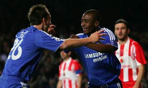 Chelsea forward Salomon Kalou celebrates scoring against Olympiakos with John Terry