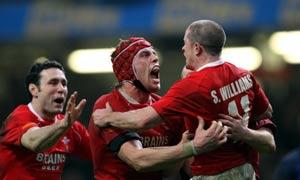 Stephen Jones, Ryan Jones and Shane Williams celebrate Wales' win