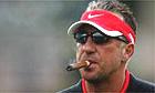 Ian Botham smokes