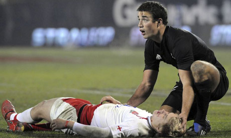 New Zealand's Richard Kahui, right, checks on an injured England's Mathew Tait after they clashed during the International rugby test in Christchurch, New Zealand, Saturday, June 21, 2008. (AP Photo/NZPA, Ross Setford)