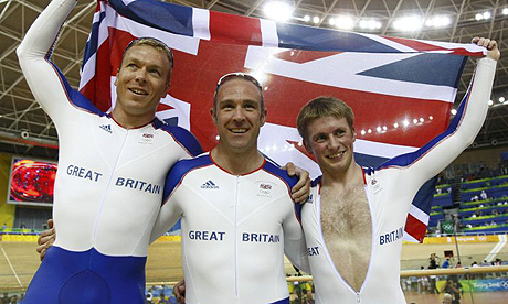 Britain's Chris Hoy, Jamie Staff and Jason Kenny celebrate winning gold in the team sprint