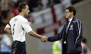 John Terry shakes hands with Fabio Capello
