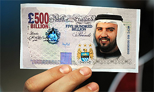 Manchester City fan holding Sulaiman Al Fahim banknote