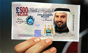 Manchester City fan holding fake note with Sulaiman Al Fahim's face