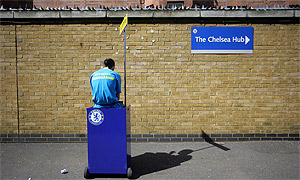 A programme seller outside Stamford Bridge